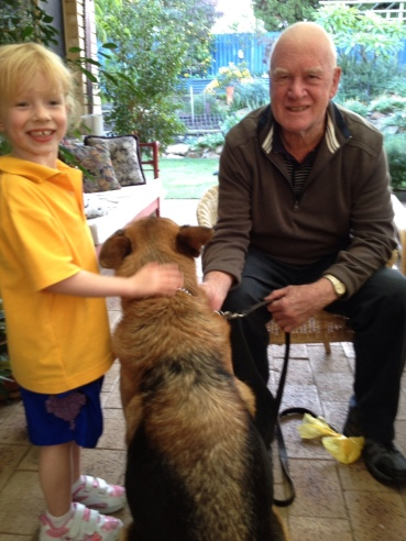 Dad and Sophie, his youngest granddaughter, taking good care of my dog Lola together.