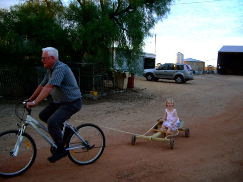 Dad and the kids - playing on the farm